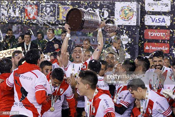 Ramiro Funes Mori of River Plate lifts the trophy after winning a final match between River Plate and Tigres UANL as part of Copa Bridgestone...