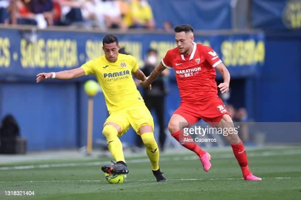 Ramiro Funes Mori of Villarreal CF is closed down by Lucas Ocampos of Sevilla during the La Liga Santander match between Villarreal CF and Sevilla FC...