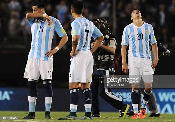 Ramiro Funes Mori Paulo Dybala and Nicolas Gaitan of Argentina react after a match between Argentina and Brazil as part of FIFA 2018 World Cup...