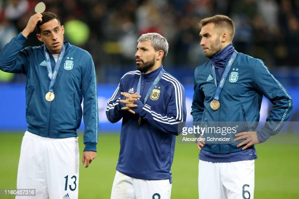 Ramiro Funes Mori Sergio Aguero and German Pezzella of Argentina react after receiving the third place medal after winning the Copa America Brazil...