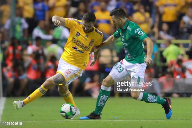 Ramiro Gonzalez of Leon struggles for the ball against Andre-Pierre Gignac of Tigres during the final second leg match between Leon and Tigres UANL...