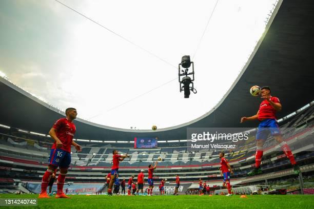 Ramiro González and Javier Güemez of San Luis warm prior to the 16th round match between Cruz Azul and Atletico de San Luis as part of the Torneo...