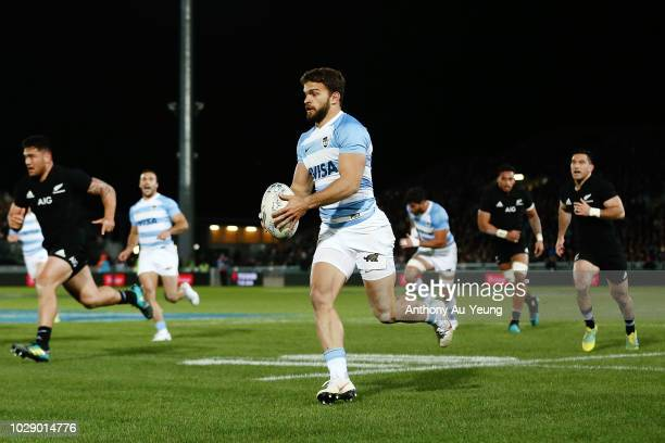 Ramiro Moyano of Argentina makes a break on his way to score a try during The Rugby Championship match between the New Zealand All Blacks and...