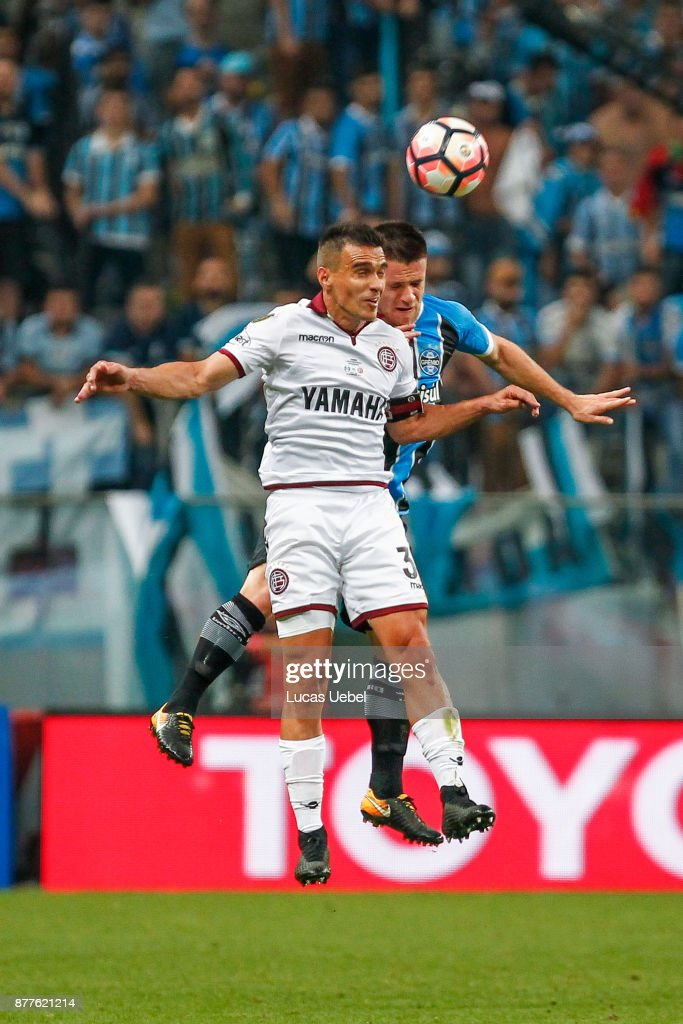 NOVEMBER 22 - Ramiro of Gremio battles for the ball against Ivan Marcone of Lanus during the match between Gremio and Lanus, part of Copa Bridgestone Libertadores 2017 Final, at Arena do Gremio on November 22, 2017, in Porto Alegre, Brazil.