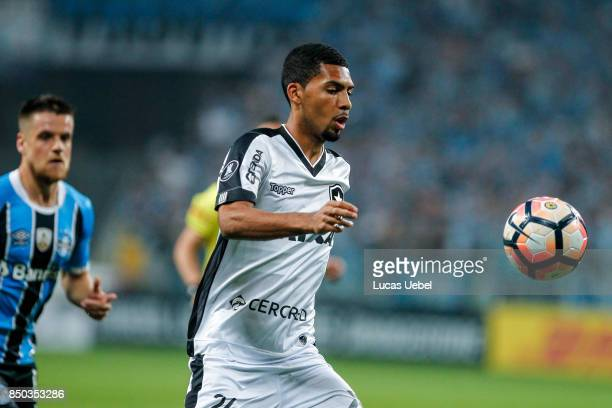 Ramiro of Gremio battles for the ball against Matheus Fernandes of Botafogo during the match between Gremio and Botafogo as part of Copa Bridgestone...