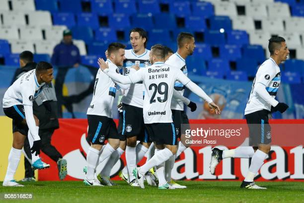 Ramiro of Gremio celebrates with teammates after scoring the opening goal of his team during a first leg match between Godoy Cruz and Gremio as part...