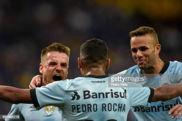 Ramiro Pedro Rocha and Luan of Gremio celebrates a scored goal against Cruzeiro during a match between Cruzeiro and Gremio as part of Brasileirao...