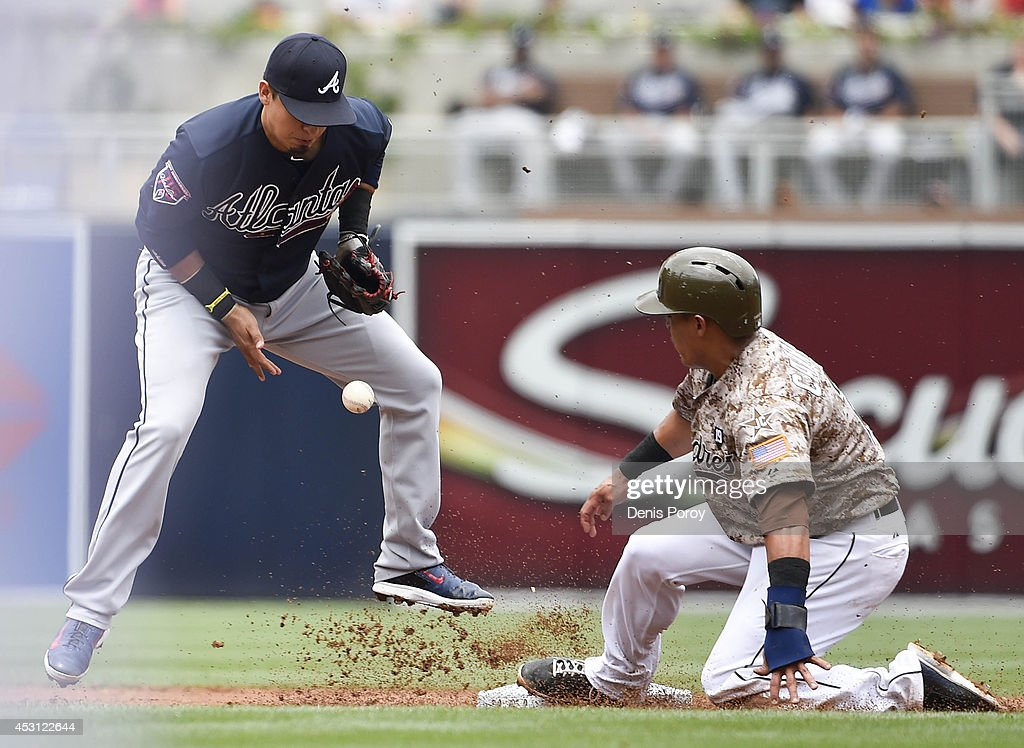 Ramiro Pena #14 of the Atlanta Braves drops the ball as Everth Cabrera #2 of the San Diego Padres steals second base during the first inning of a baseball game at Petco Park August 3, 2014 in San Diego, California.