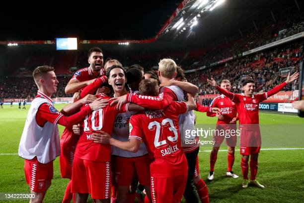 Ramiz Zerrouki of FC Twente celebrates with his team mates his sides third goal during the Dutch Eredivisie match between FC Twente and AZ at De...