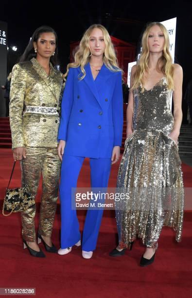 Ramla Ali Elfie Reigate and Ella Richards arrive at The Fashion Awards 2019 held at Royal Albert Hall on December 2 2019 in London England