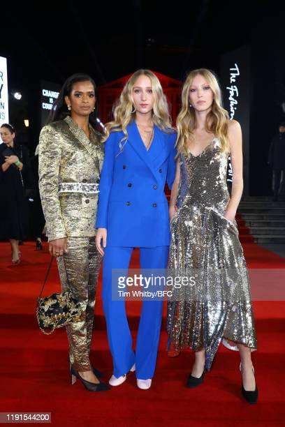 Ramla Ali Elfie Reigate and Ella Richards arrive at The Fashion Awards 2019 held at Royal Albert Hall on December 02 2019 in London England