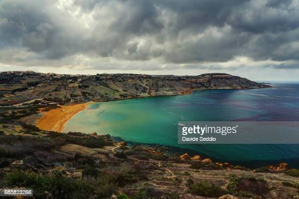 Ramla Bay beach viewed from the Tal-Mixta Cave in a cloudy day