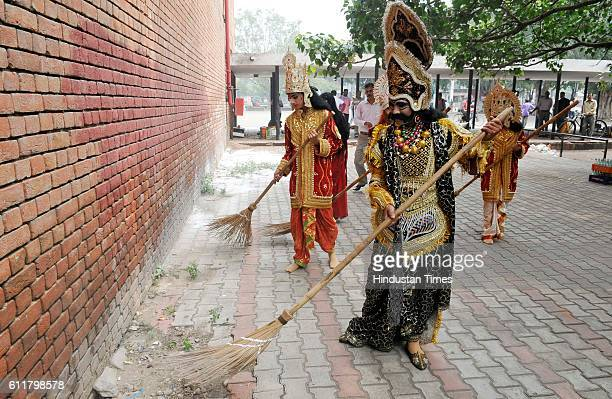 Ramleela Artists from Navyug Ramleela taking a part in cleanliness drive campaign at Plaza sector 17 on October 1 2016 in Chandigarh India Swachh...