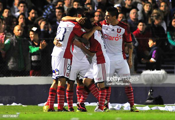 Ramón Fernández of Universidad de Chile celebrates a scored goal with teammates during a match between Defensor Sporting and U de Chile as part of...