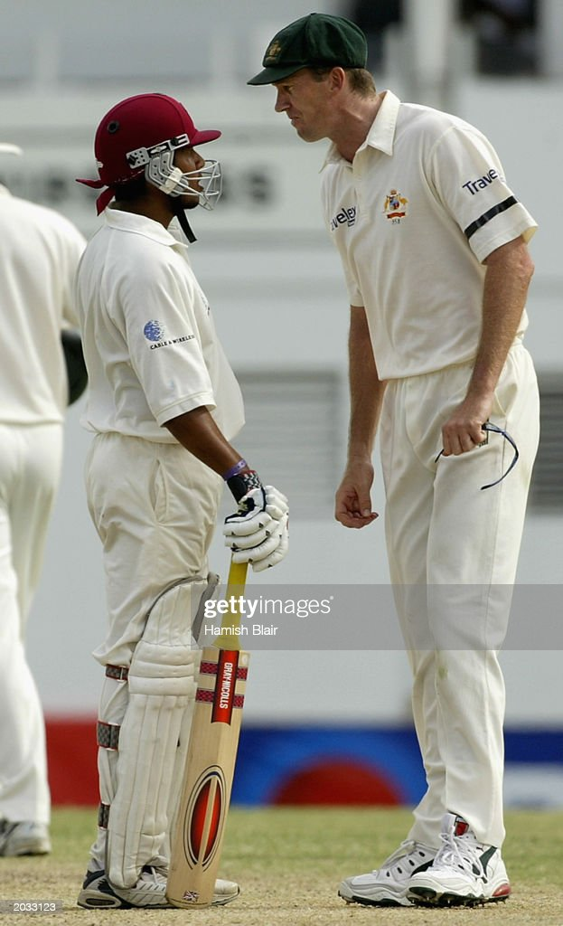 Ramnaresh Sarwan of the West Indies and Glenn McGrath of Australia confront each other during day four of the fourth test between the West Indies and Australia played on May 12, 2003 at the Recreation Oval in St John's, Antigua.
