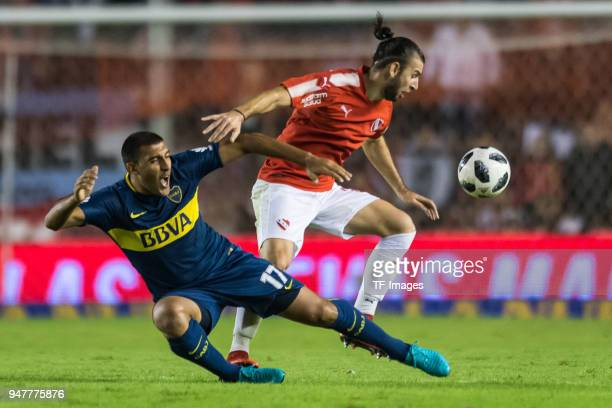 Ramon Abila of Boca Juniors and Gaston Silva of Independiente battle for the ball during a match between Independiente and Boca Juniors as part of...