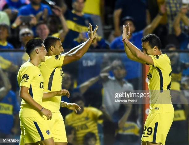 Ramon Abila of Boca Juniors celebrates with teammate after scoring the fourth goal of his team during a match between Boca Juniors and San Martin de...