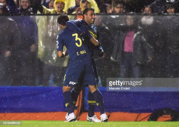 Ramon Abila of Boca Juniors celebrates with teammates after scoring the first goal of his team during a first leg match between Boca Juniors and...