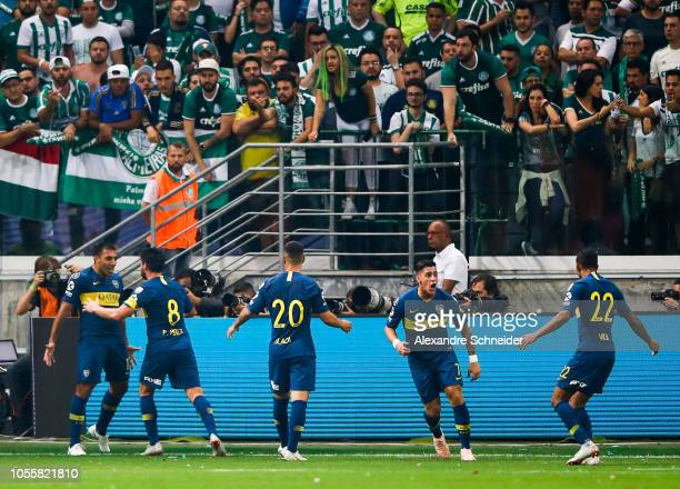 Ramon Abila of Boca Juniors celebrates with teammates after scoring the opening during the match against Palmeiras for the Copa CONMEBOL Libertadores...