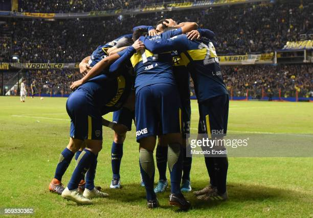 Ramon Abila of Boca Juniors celebrates with teammates after scoring the third goal of his team during a match between Boca Juniors and Alianza Lima...