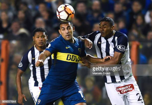 Ramon Abila of Boca Juniors fights for the ball with Aldair Fuentes of Alianza Lima during a match between Boca Juniors and Alianza Lima at Alberto J...