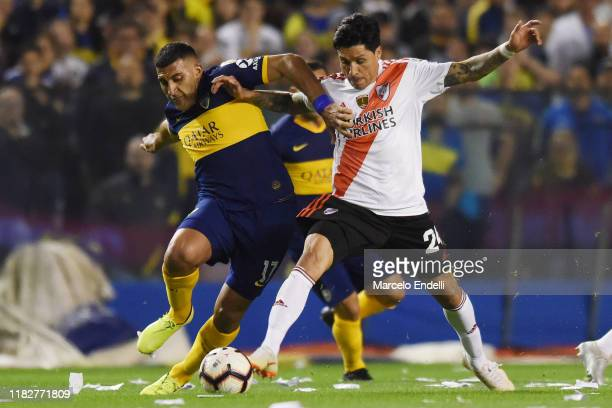 Ramon Abila of Boca Juniors fights for the ball with Enzo Perez of River Plate during the Semifinal second leg match between Boca Juniors and River...