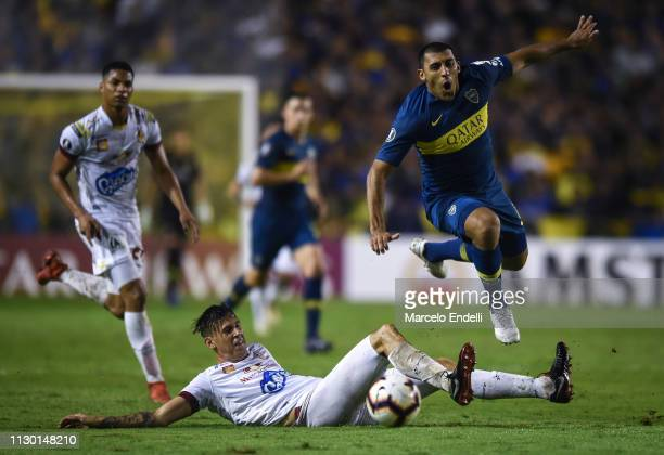 Ramon Abila of Boca Juniors fights for the ball with Juan Vargas of Deportes Tolima during a group G match between Boca Juniors and Deportes Tolima...