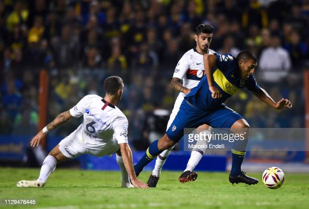 Ramon Abila of Boca Juniors fights for the ball with Marcos Senesi of San Lorenzo during a match between Boca Juniors and San Lorenzo as part of...