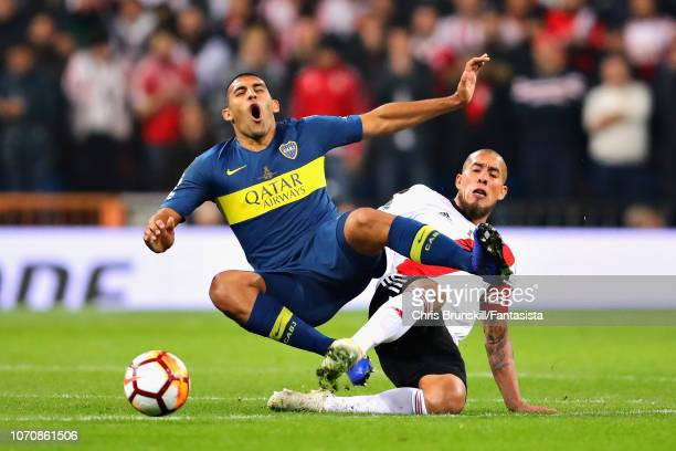 Ramon Abila of Boca Juniors is tackled by Leonardo Ponzio of River Plate during the second leg of the final match of Copa CONMEBOL Libertadores 2018...