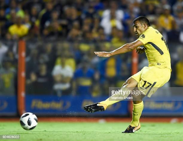 Ramon Abila of Boca Juniors kicks the ball to score the fourth goal of his team during a match between Boca Juniors and San Martin de San Juan as...