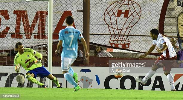 Ramon Abila of Huracan shoots to score the second goal of his team during a match between Huracan and Sporting Cristal as part of Group 4 of Copa...