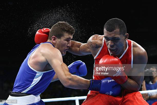 Ramon Albert Ramirez of Venezuela fights Abdelhafid Benchabla of Algeria in their Mens Light Heavyweight bout on Day 6 of the 2016 Rio Olympics at...