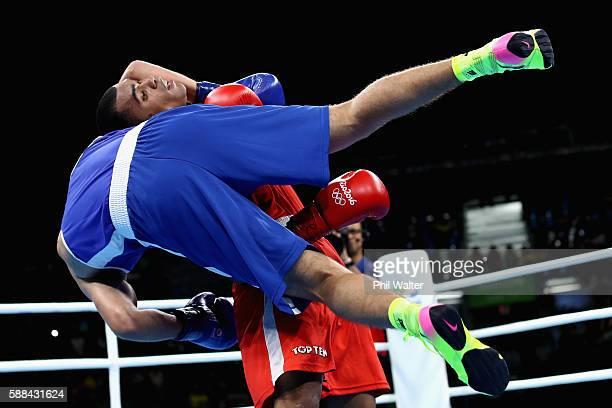Ramon Albert Ramirez of Venezuela lifts Abdelhafid Benchabla of Algeria in their Mens Light Heavyweight bout on Day 6 of the 2016 Rio Olympics at...
