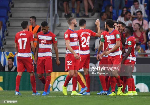 Ramon Azeez of Granada celebrates with team mates after scoring his team's third goal during the La Liga match between RCD Espanyol and Granada CF at...