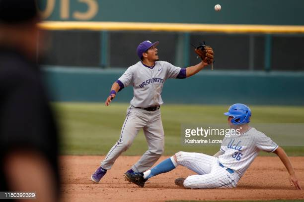 Ramon Bramasco of University of Washington juggles the ball as he tries to tag Jake Pries of UCLA out at second during a baseball game at Jackie...