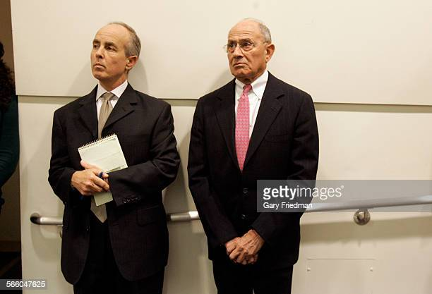 Ramon C Cortines Sr Deputy Superintendent for the LAUSD and Jim Morris Chief of Staff for LAUSD listens to David L Brewer III as Brewer announced at...