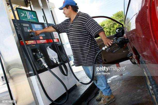 Ramon Carcamo puts gas into his vehicle September 15 2008 in Miami Florida Gasoline prices rose nearly 5 cents a gallon Monday bringing the total...