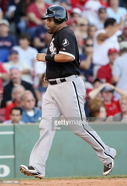 Ramon Castro of the Chicago White Sox scored the game winning run on a bases loaded walk in the ninth inning against the Boston Red Sox September 5...