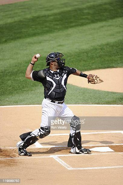 Ramon Castro of the Chicago White Sox throws the ball toward second base during the game against the Minnesota Twins on July 9 2011 at US Cellular...