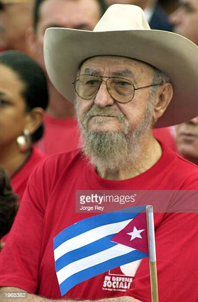 Ramon Castro Ruz brother of the Cuban President Fidel Castro listens to a speech during May Day celebrations at Revolution Plaza May 1 2003 in Havana...