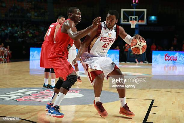Ramon Clemente and Nestor Colmenares in action during a game of the 2015 FIBA Americas Championship between Venezuela and Puerto Rico at the Palacio...