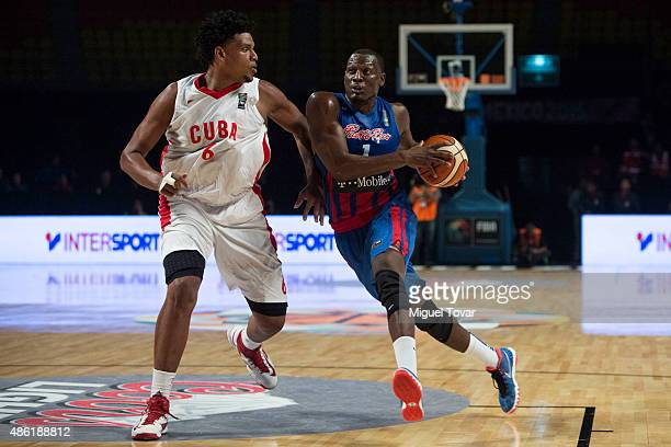 Ramon Clemente of Puerto Rico goes for the basket as Javier Justiz of Cuba defends during a match between Brazil and Dominican Republic as part of...