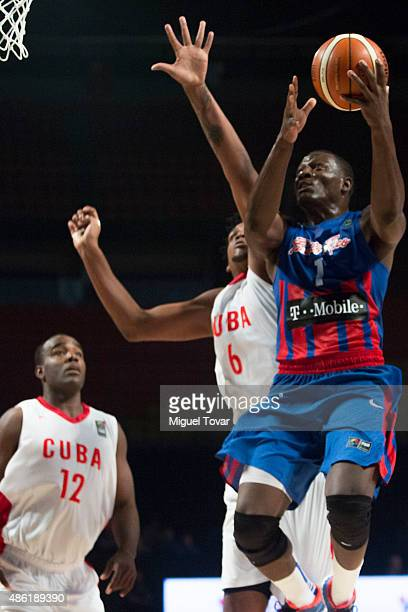 Ramon Clemente of Puerto Rico goes goes up against Javier Justiz of Cuba during a match between Brazil and Dominican Republic as part of the 2015...