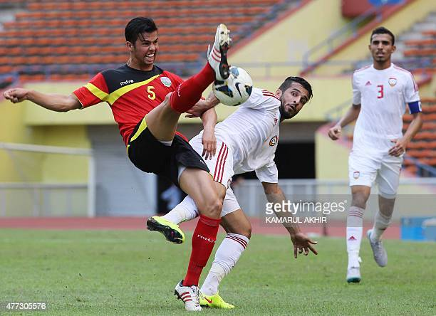Ramon De Lima Saro of East Timor fights for the ball with Ali Ahmed Mabkhout of the UAE during the 2018 FIFA World Cup football qualifying match...