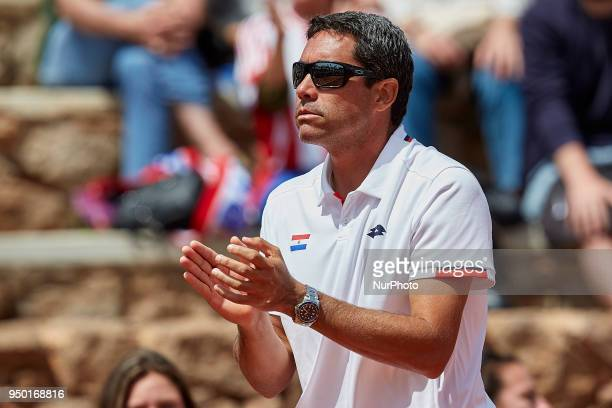 Ramon Delgado Captain of Paraguay reacts during day two of the Fedcup World Group II Playoffs match between Spain and Paraguay at Centro de Tenis La...