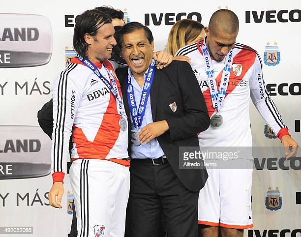 Ramon Diaz and Fernando Cavenaghi celebrate at the end of Torneo Final 2014 as part of 19th round of Torneo Final 2014 at Monumental Antonio Vespucio...