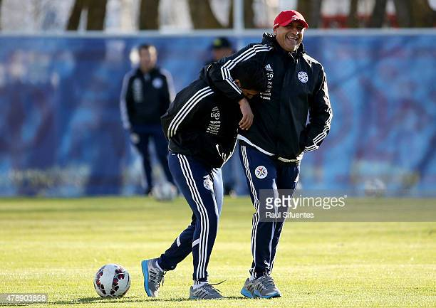 Ramon Diaz coach of Paraguay and his son Emiliano Diaz coach assistant joke during a training session at ENAP training camp as part of 2015 Copa...