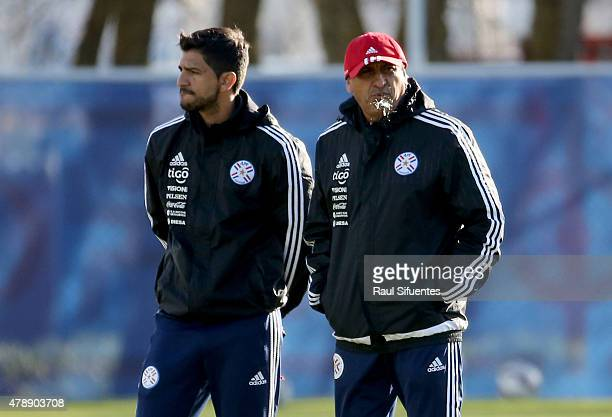Ramon Diaz coach of Paraguay and his son Emiliano Diaz coach assistant look on during a training session at ENAP training camp as part of 2015 Copa...