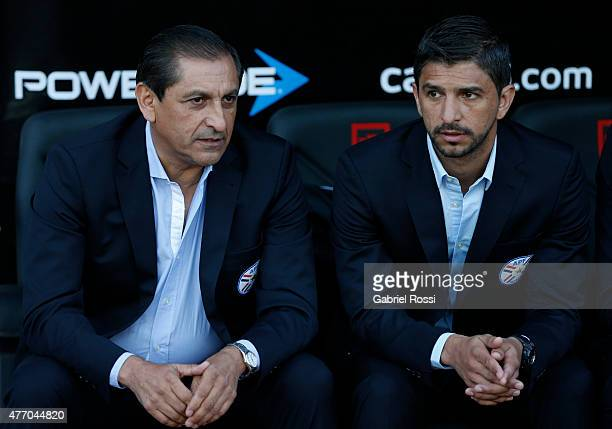 Ramon Diaz coach of Paraguay and his son Emiliano Diaz coach assistant watch the game during the 2015 Copa America Chile Group B match between...