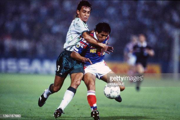 Ramon Diaz of Yokohama Marinos and Luiz Carlos Pereira of Verdy Kawasaki compete for the ball during the JLeague Suntory Series match between...